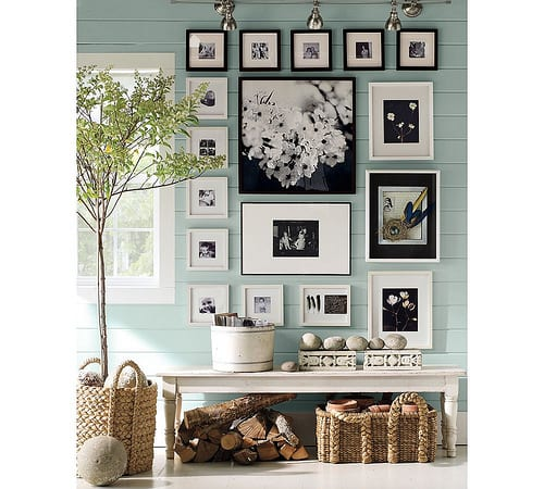 aqaua-walls-black-white-photos-in-black-frames-white-bench