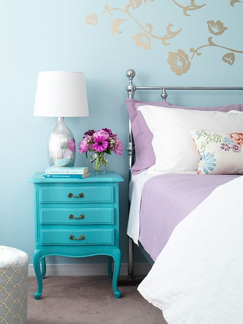 turquoise-bedroom-walls-silver-lamp-diy-painted-nightstand-purple-bedding-floral-throw-pillow