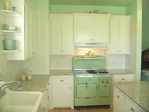vintage-kitchen-jade-green-stove-white-cabinets-granite-countertops
