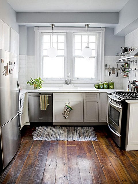 white-kitchen-cabinets-subway-tile-stainless-steel-appliances-blue-walls-plank-wood-floors