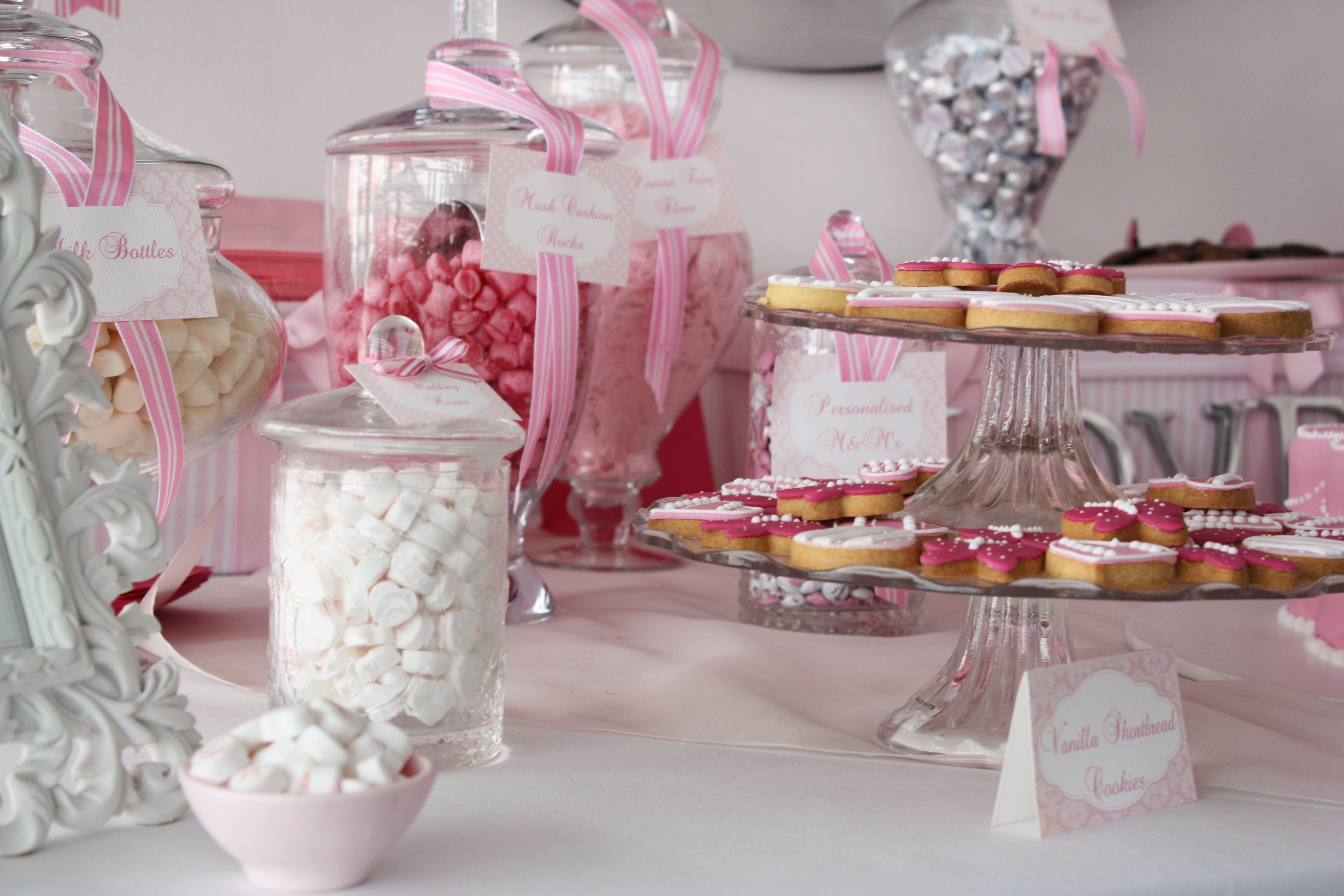 white pink candy buffet cookie bar wedding ideas The Sweetest