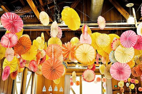 yellow-pink-orange-colorful-wedding-recipetion-decor-paper-pinwheels