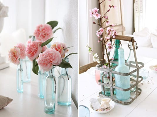 blue-vintage-glass-bottles-affordable-centerpiece-ideas-cherry-blossoms-pink-garden-roses
