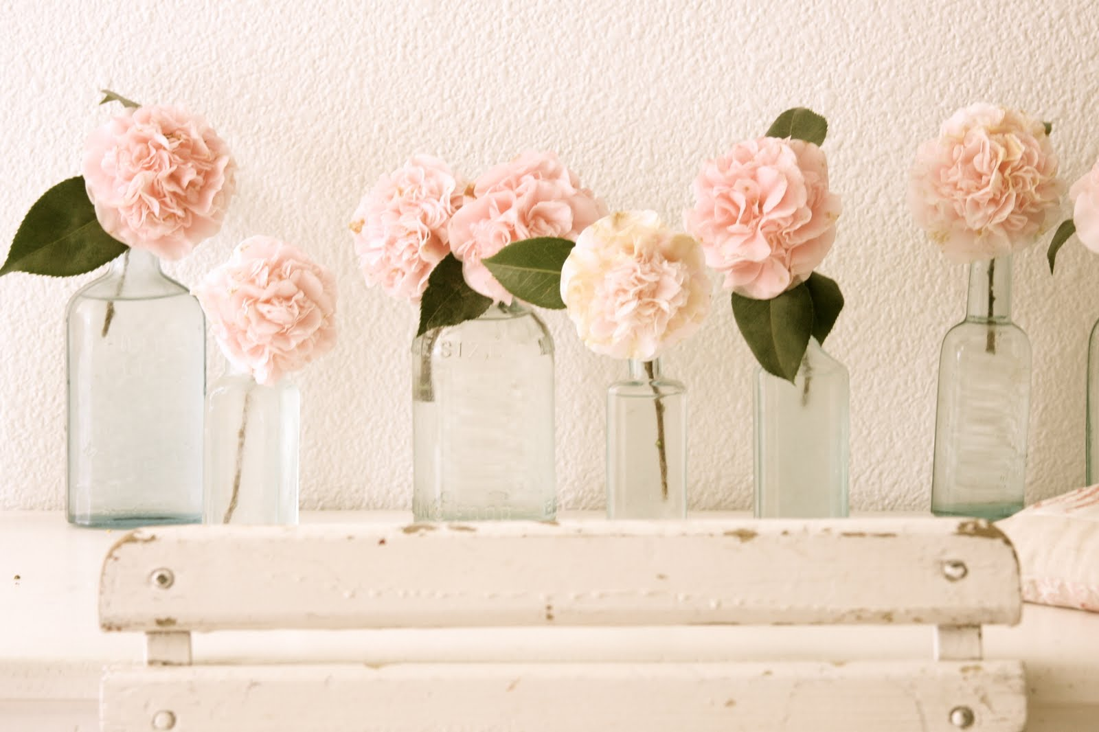 Vintage glass bottles centerpieces pink garden roses