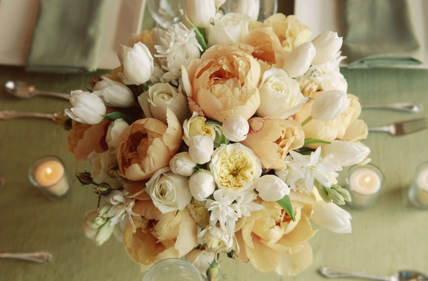 Peach peonies white tulip centerpiece the sweetest