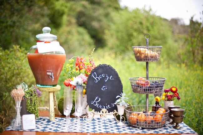 bohemian wedding al fresco Think bright wild blooms mixed with antique
