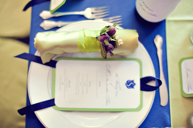 buds from Flower Factory tucked inside napkin rings wrapped in ribbon