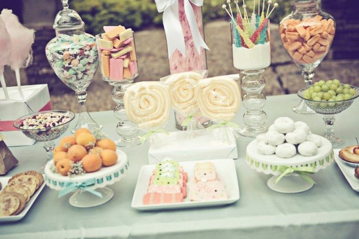 With creativity and lots of candy accents a candy themed bridal shower can