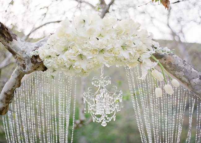 decadent white flowers and loads of shimmery glassware and metallic ...