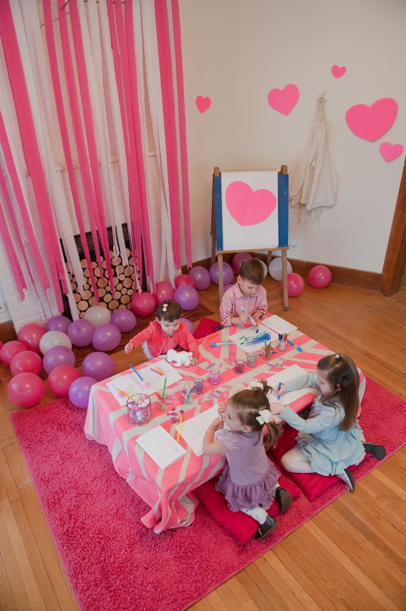 A neon pink kiddie valentines day celebration the Valentine stage decorations
