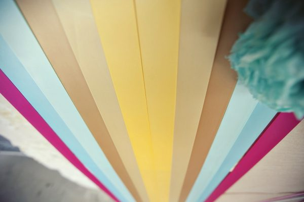 Ribbon photo booth backdrop from a chic summer rehearsal dinner on The Sweetest Occasion
