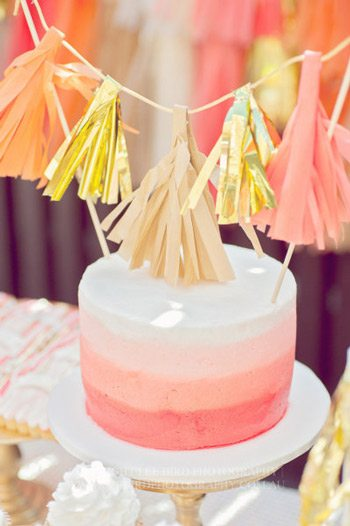 A peach, coral + gold first birthday party