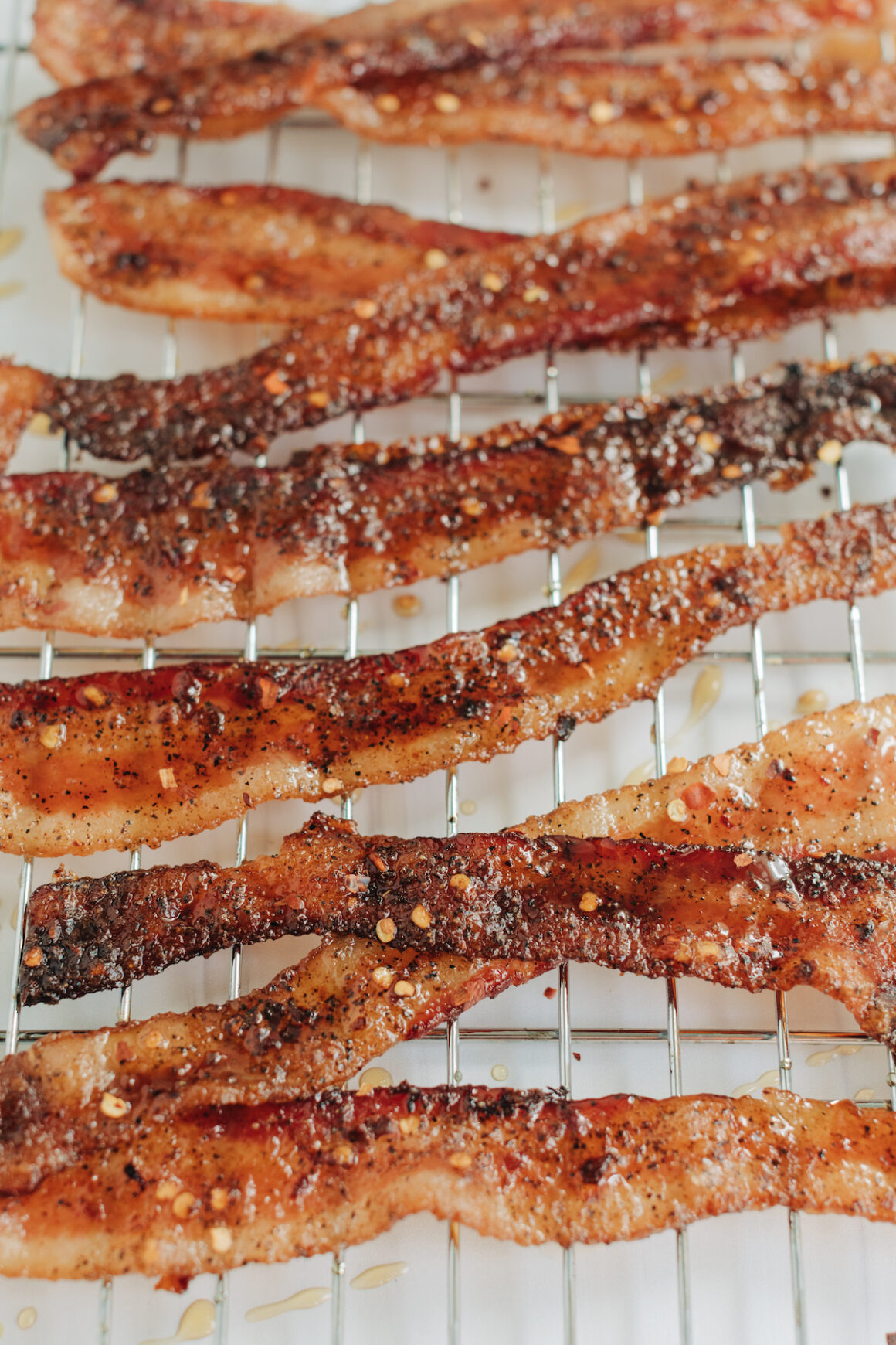 Candied Million Dollar bacon on a baking rack