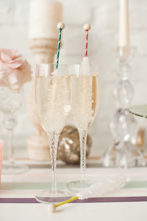 Champagne with Rock Candy Swizzle Sticks from @cydconverse