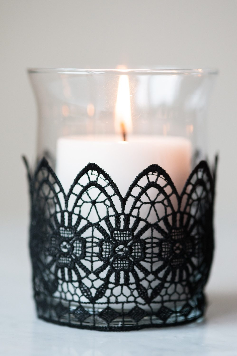 load these bad boys up with candles i personally prefer white candles with the black lace give them a light and you have instant halloween decor - Diy Candle Holders