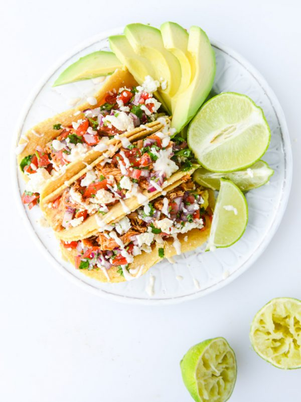 Easy Chicken Tacos Recipe | Get your fix of taco recipes and the ultimate classic margarita recipe and loads of Cinco de Mayo party ideas at The Sweetest Occasion! Click to check it out or repin to save for later!
