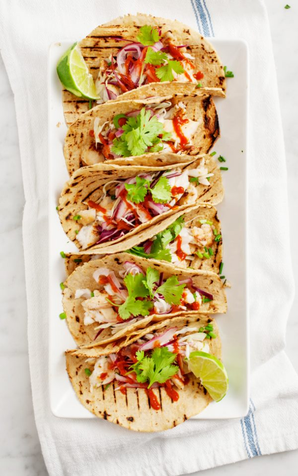 Tequila Lime Fish Tacos Recipe | Get your fix of taco recipes and the ultimate classic margarita recipe and loads of Cinco de Mayo party ideas at The Sweetest Occasion! Click to check it out or repin to save for later!