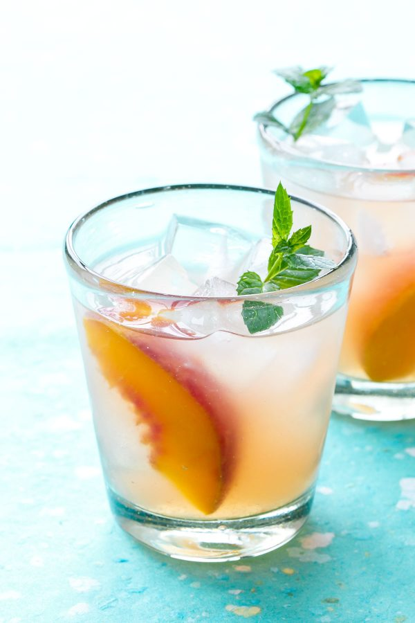 Bourbon Peach Sangria | 15 Sangria Recipes for Late Summer and Fall | Cocktail recipes, entertaining tips and party ideas from @cydconverse