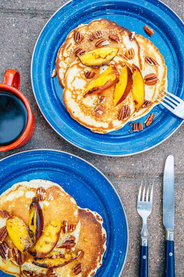 Campfire Pancakes with Grilled Peaches | 12 Delicious Camping Recipes from @cydconverse plus camping tips and a camping packing list!