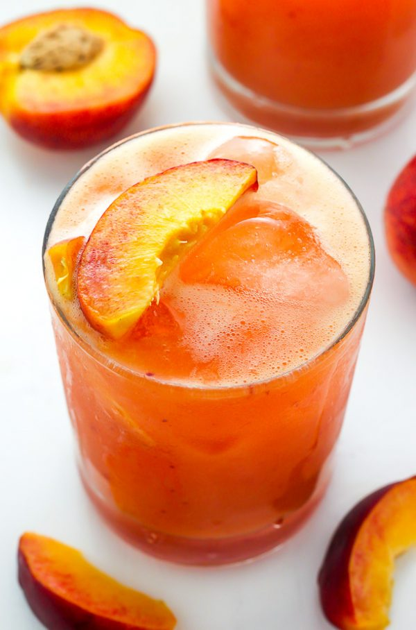 Fresh Peach Sangria | 15 Sangria Recipes for Late Summer and Fall | Cocktail recipes, entertaining tips and party ideas from @cydconverse