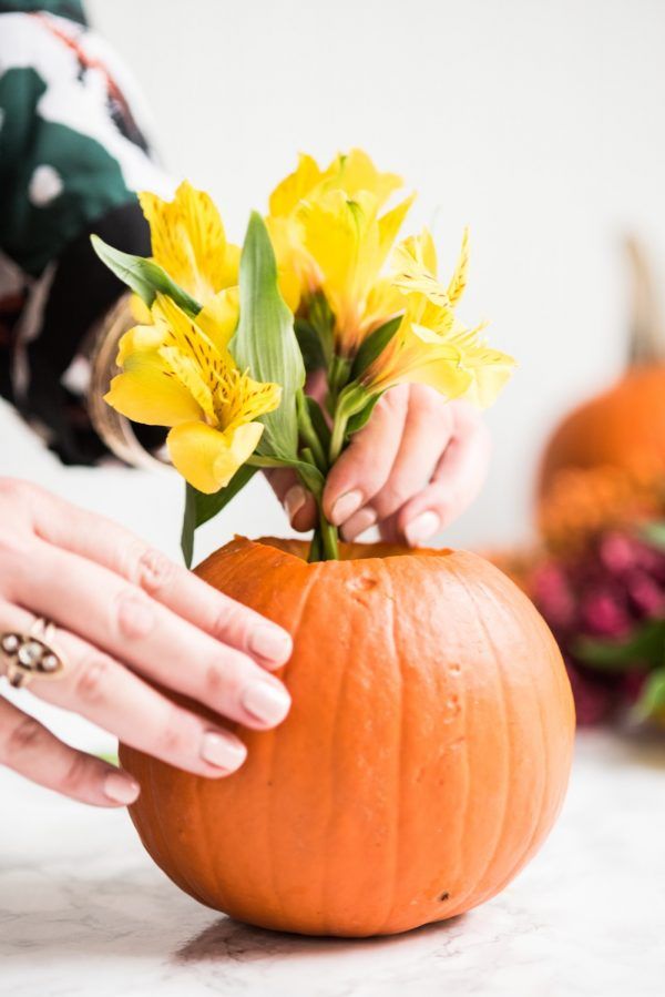 DIY Pumpkin Flower Arrangements   Thanksgiving ideas, Thanksgiving crafts, Thanksgiving table ideas and more DIY projects from @cydconverse
