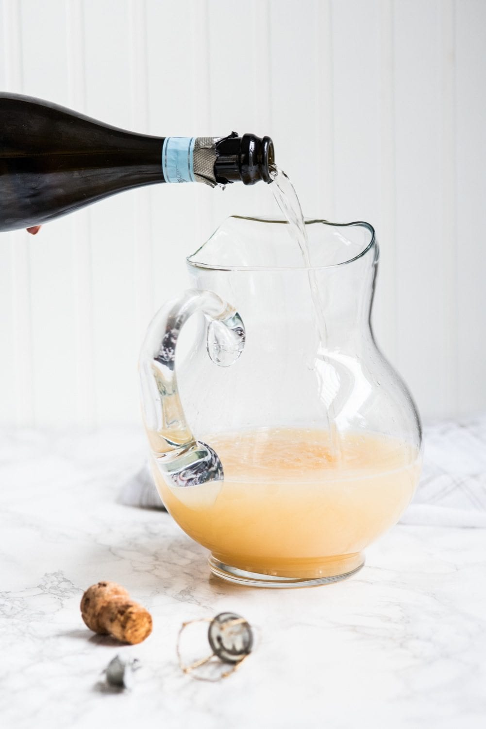Fizzy Spiked Pear Punch Champagne Cocktail | Cocktail recipes, entertaining ideas, party recipes, party ideas and more from @cydconverse