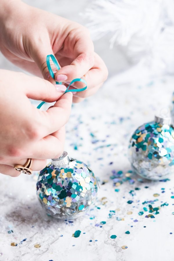 DIY Glitter Confetti Ornaments | Christmas craft ideas, homemade ornaments, Christmas recipes and more from @cydconverse
