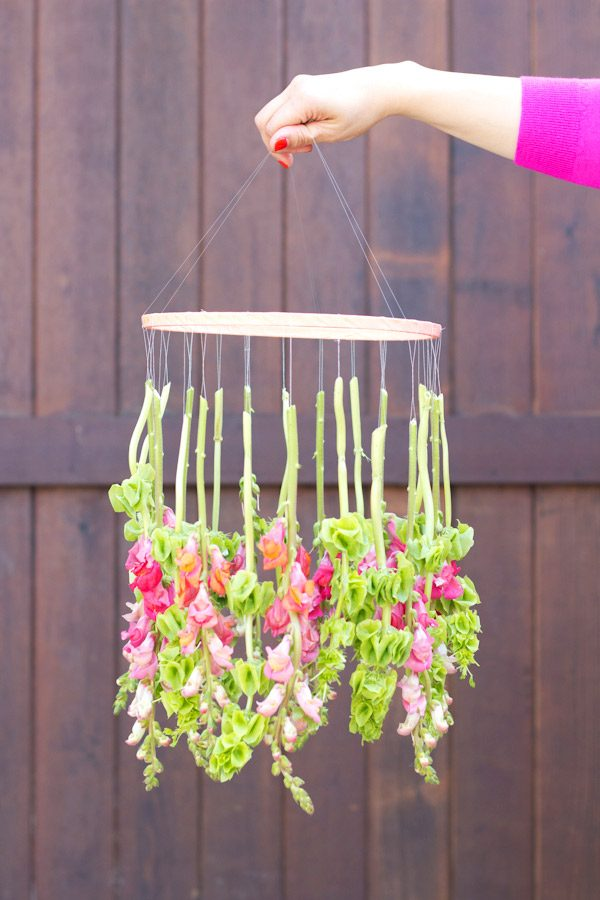DIY Hanging Flower Chandelier | DIY ideas, spring craft ideas, first day of spring ideas and more from @cydconverse
