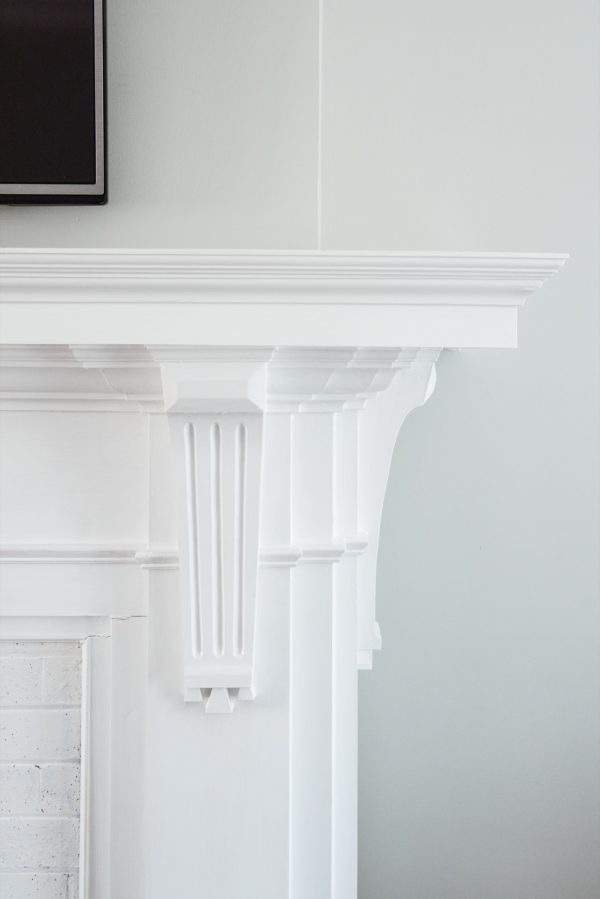 A Budget-Friendly DIY Fireplace Makeover for Under $30 | Easy home reno projects, fireplace ideas, tips for how to paint a fireplace and how to paint brick from @cydconverse
