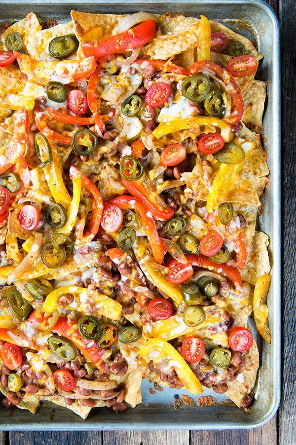 Veggie Fajita Sheet Pan Nachos | Friday night dinner ideas, easy dinner recipes, weeknight dinner ideas and more from @cydconverse