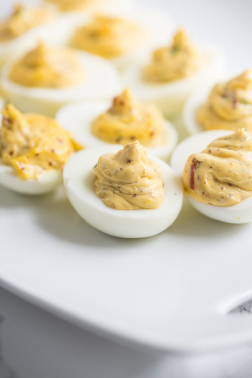 Red Pepper + Chive Deviled Eggs - The Sweetest Occasion