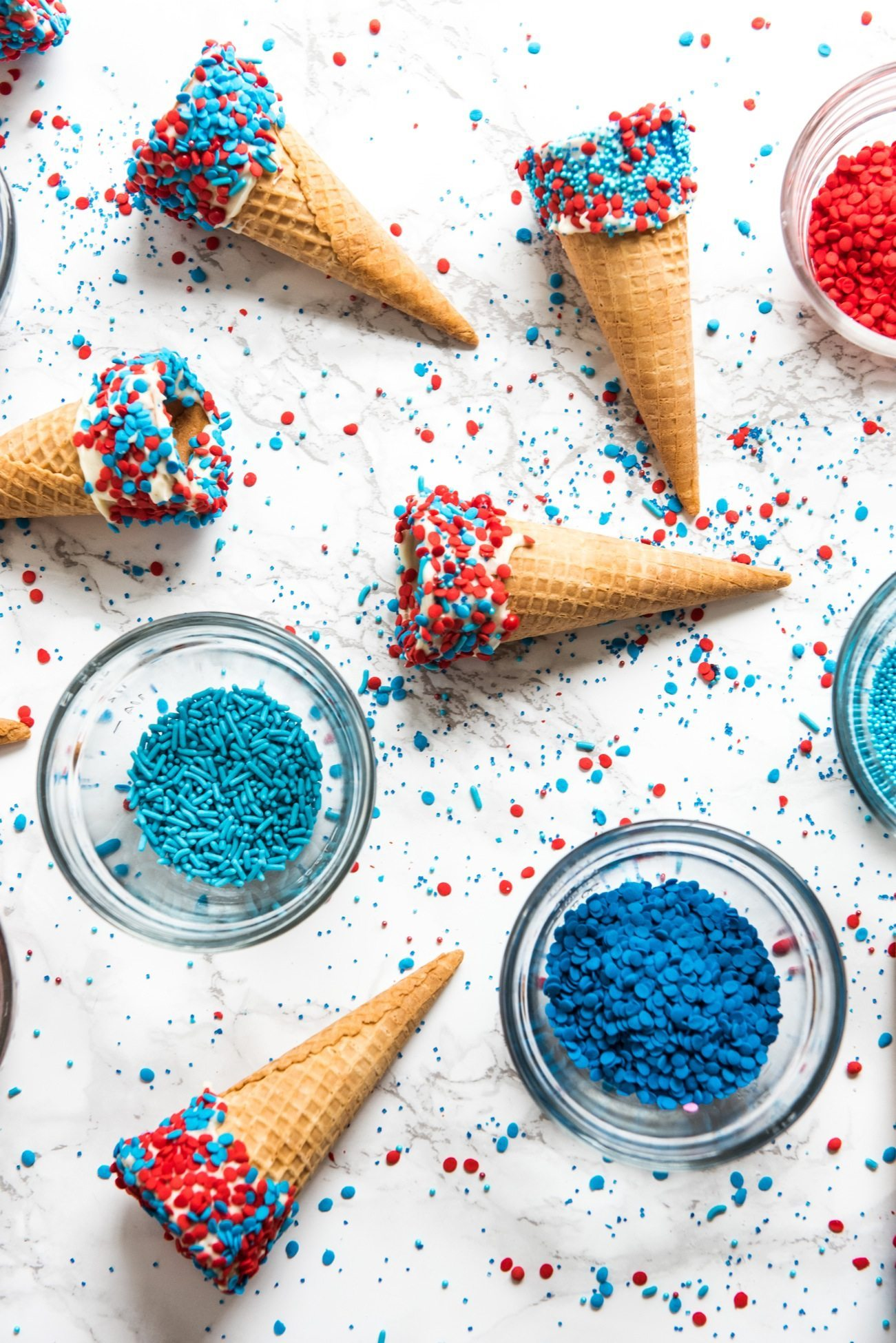 4th of July Desserts: Sprinkle Dipped Ice Cream Cones | Follow @cydconverse for more entertaining ideas, recipes, cocktail recipes, party themes and more!
