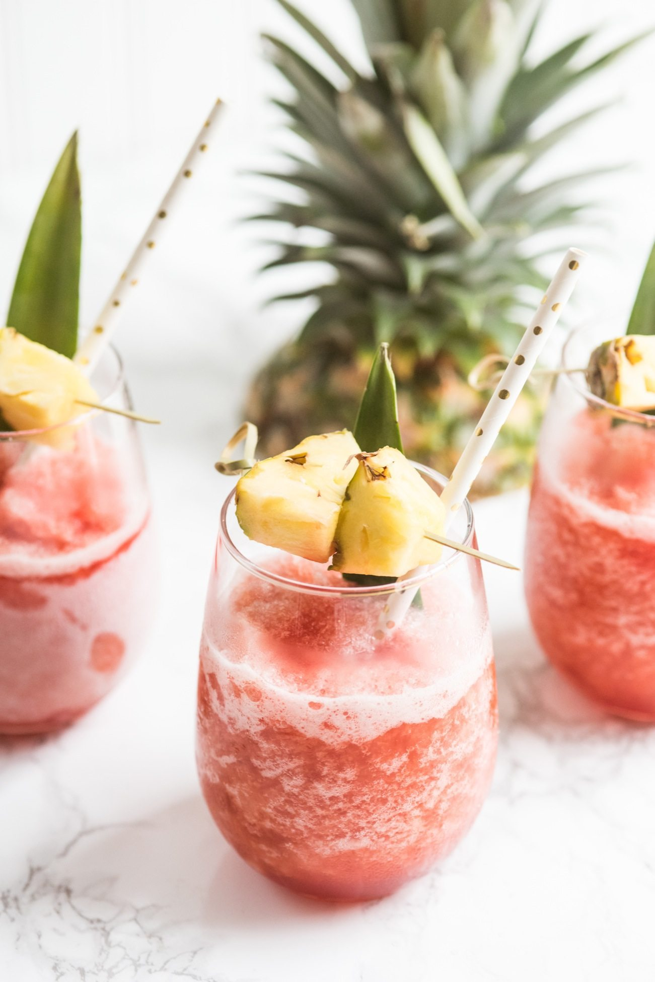 Coconut Pineapple Rum Slush Tropical Cocktail Recipe | Tropical cocktails, cocktail recipes, party ideas, entertaining tips and more from @cydconverse