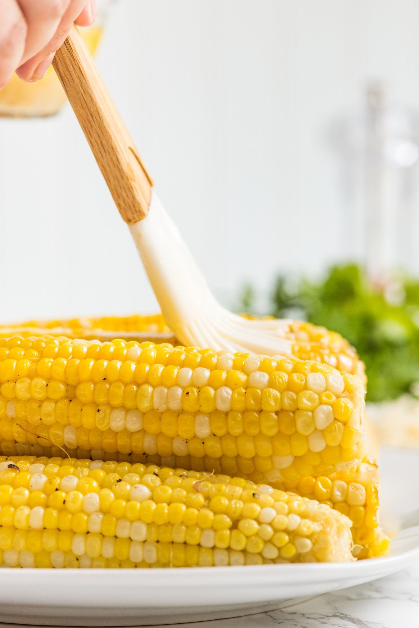 Garlic Parmesan Grilled Corn Recipe | Party recipes, entertaining tips, party ideas and more from @cydconverse