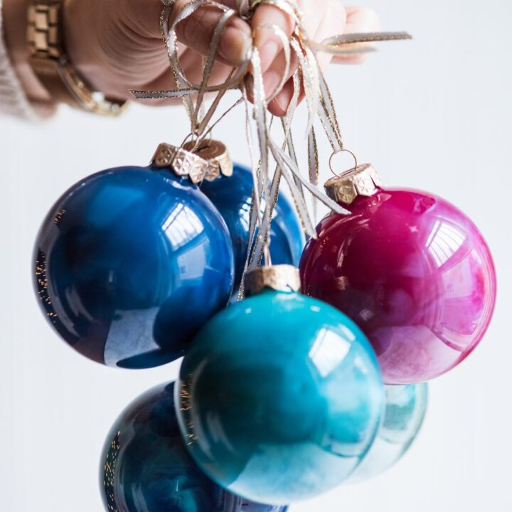 DIY Swirled Melted Crayon Ornaments | DIY ornaments, holiday entertaining tips, holiday cocktail recipes, homemade ornaments and more from @cydconverse