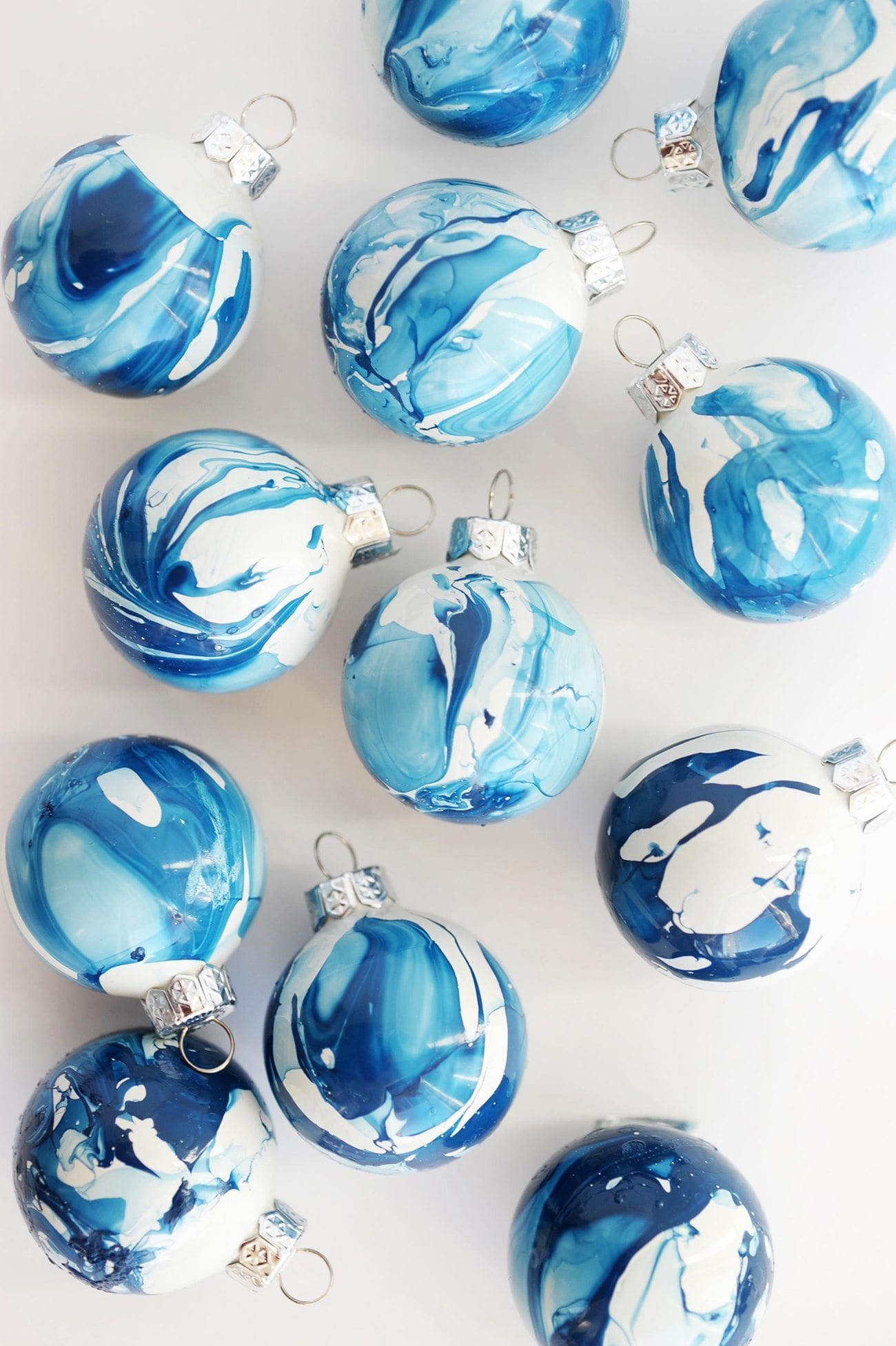 10 gorgeous homemade ornaments you can make with simple glass diy indigo marbled ornaments easy glass ornament craft ideas from cydconverse solutioingenieria Gallery