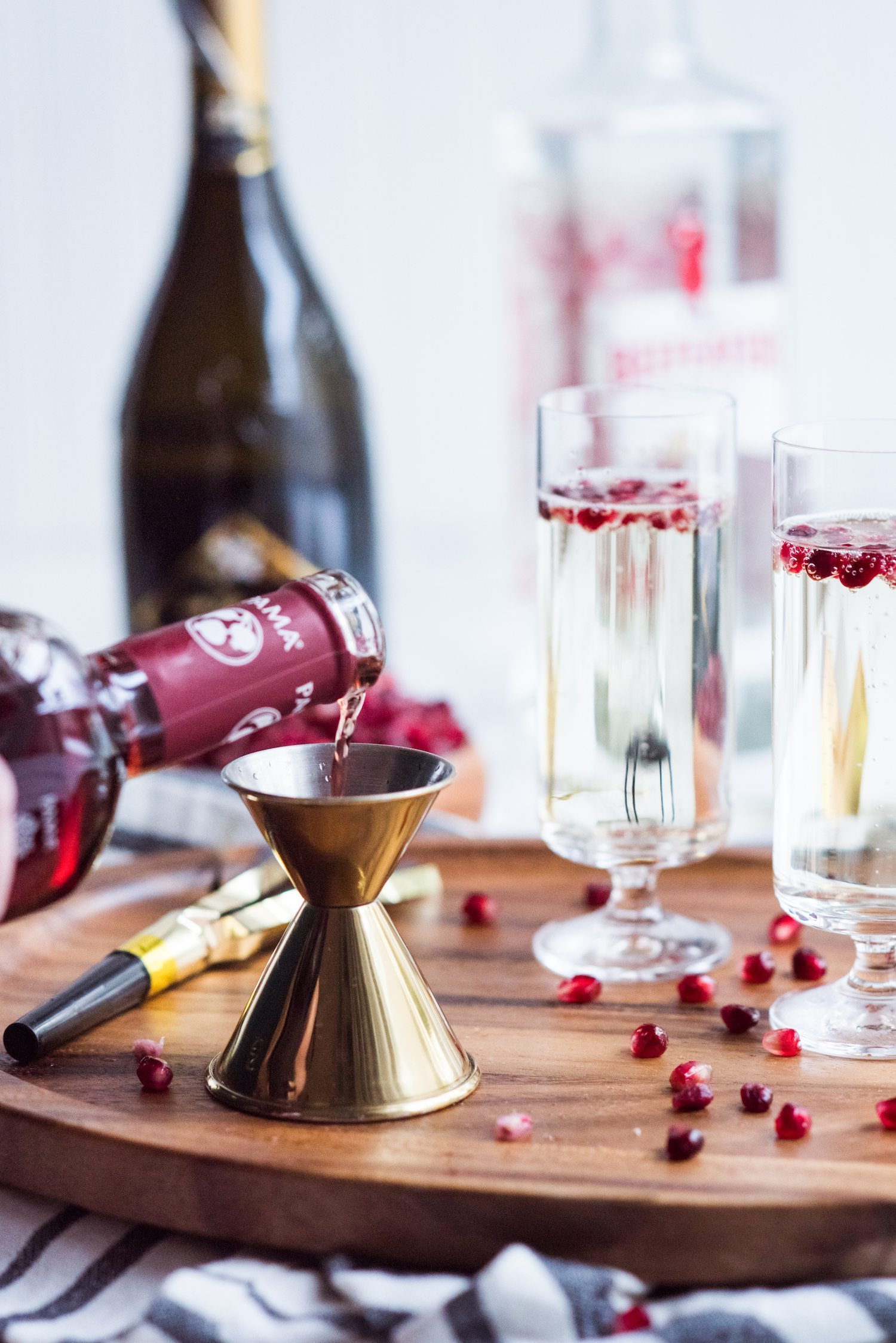 Sparkling Pomegranate French 75 Recipe | New Year's Eve cocktail recipes, entertaining tips, New Year's Eve party ideas and more from @cydconverse