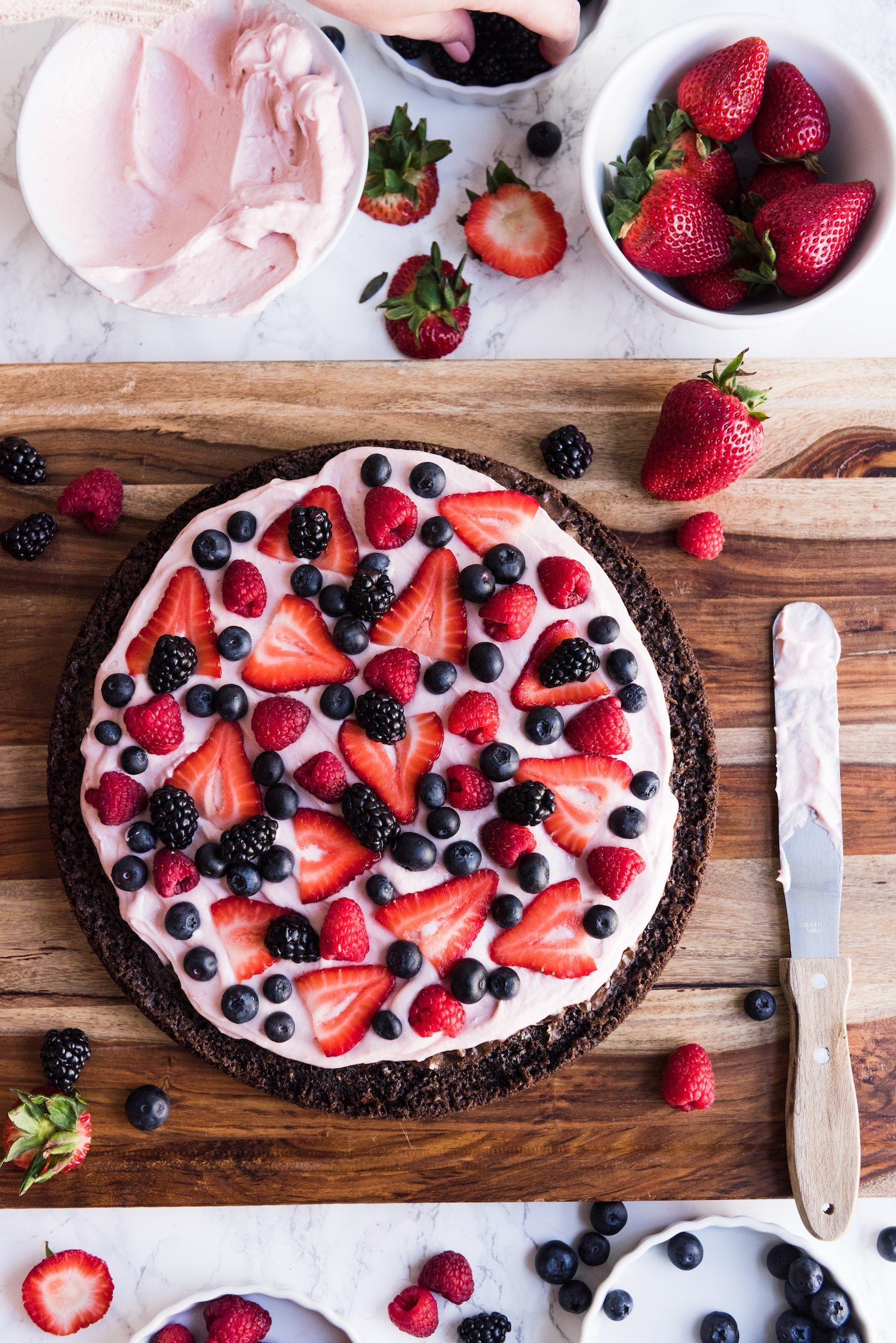 Brownie Pizza Recipe with Strawberry Buttercream Frosting | Love entertaining? Visit The Sweetest Occasion for fun party recipes, entertaining tips, festive cocktail recipes, party ideas and more!