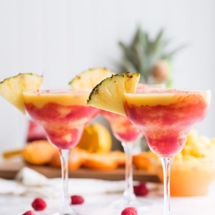 Raspberry Swirl Pineapple Mango Margaritas | Entertaining tips, cocktail recipes, party recipes and more from @cydconverse