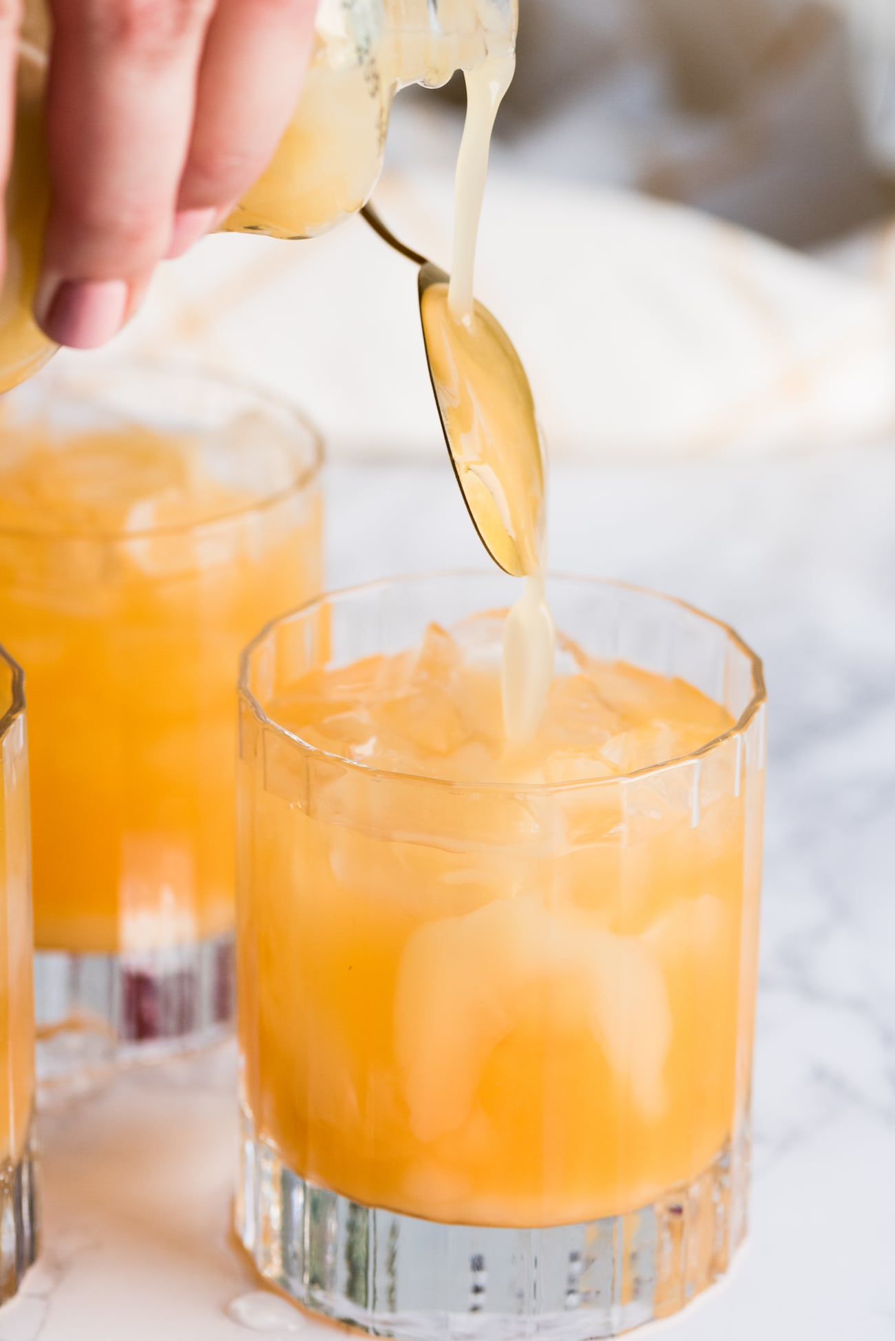 Mango Sunrise Piña Coladas from entertaining blog @cydconverse - Click through for entertaining tips, party ideas, recipes, cocktail recipes, party appetizers and more!