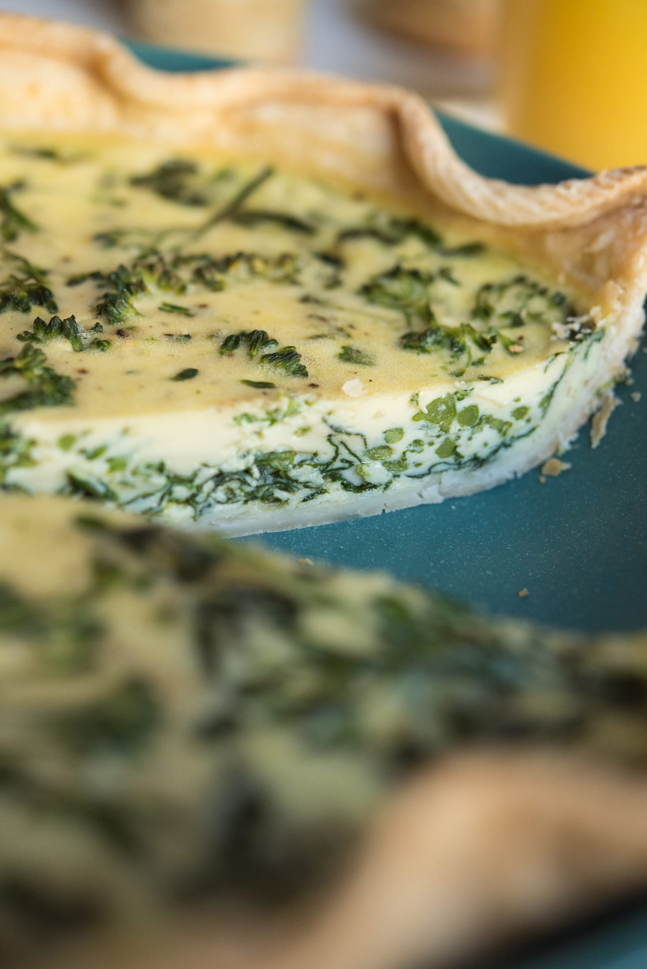 Spinach and Broccolini Goat Cheese Quiche | Friendsgiving recipes, Thanksgiving recipes, party ideas and entertaining tips from entertaining blog @cydconverse