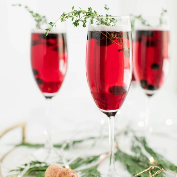 Champagne cocktails make the best Christmas cocktails! This blueberry bubbly sparkler is the perfect Christmas cocktail recipe. See more from entertaining blog @cydconverse!