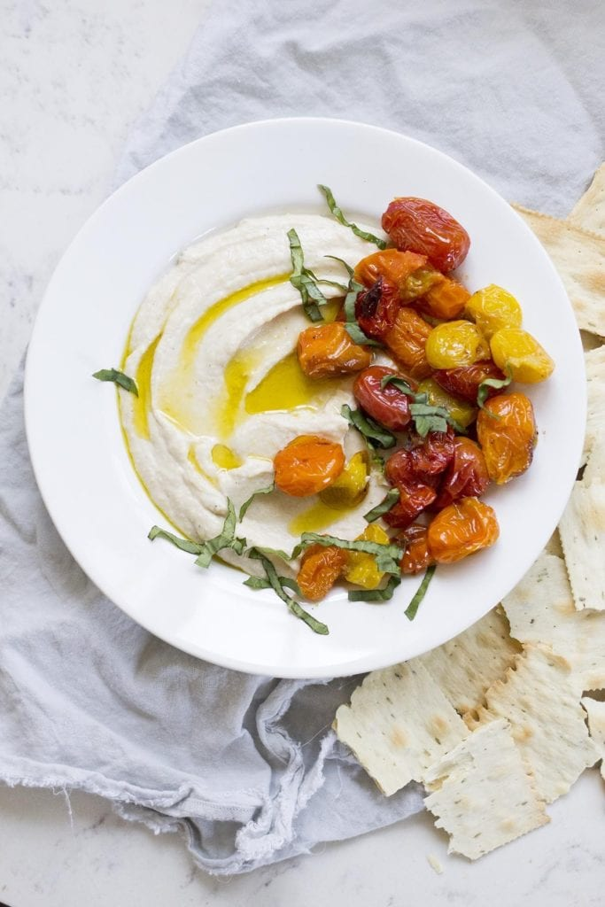 Ricotta and white bean dip with roasted tomatoes