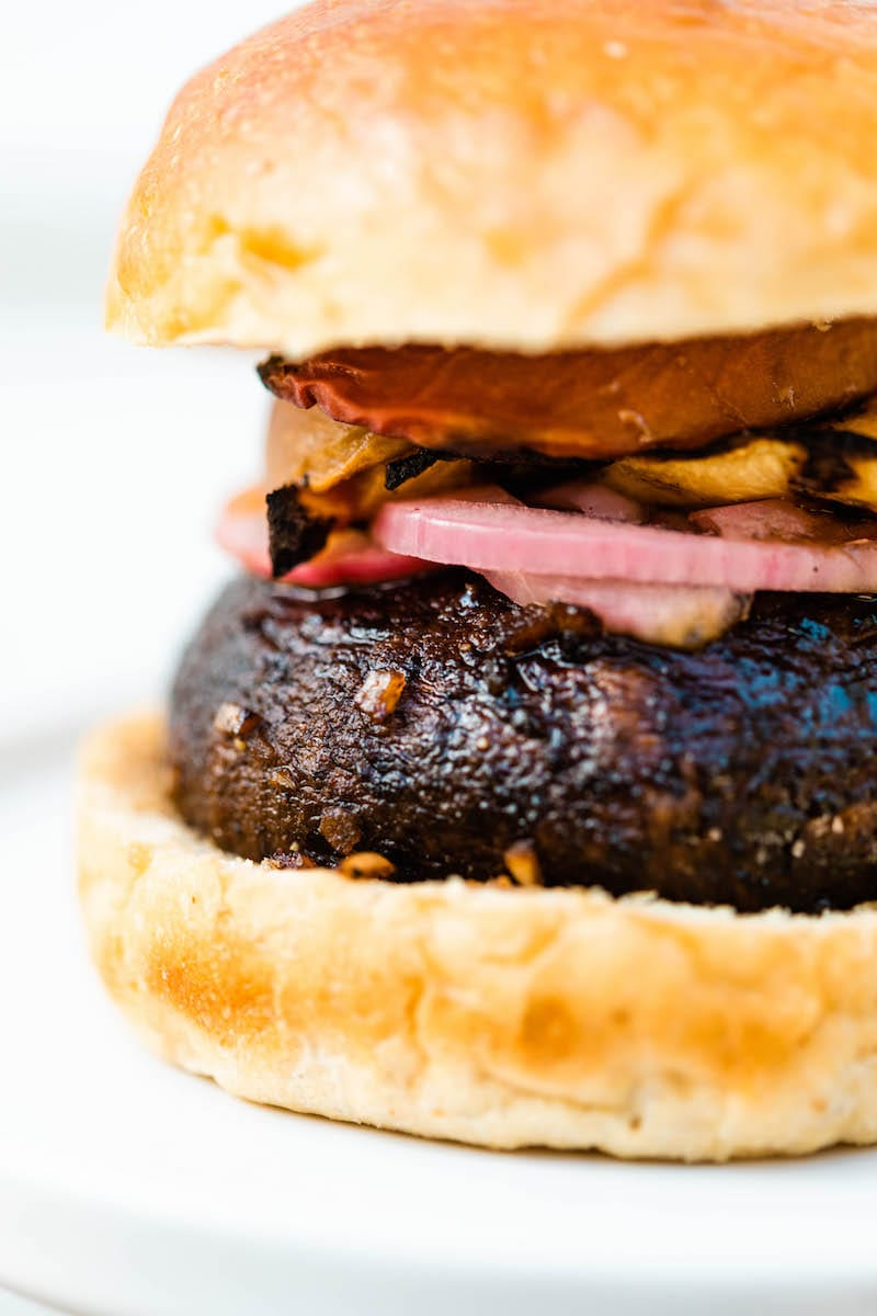 Grilled Portobello Burgers with Grilled Peaches + Pickled Red Onions | Easy grilling recipes for summer parties from @cydconverse